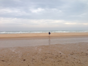My husband wading into the waters at Omaha Beach