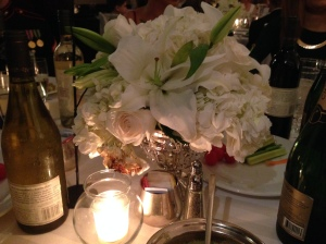 The centerpiece of white roses, lilies and hydrangea