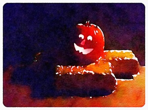 Jack-o-Lantern and hay bales on our front porch