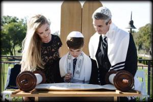 Ryan and his parents with the Torah  Maria McCarthy Photography